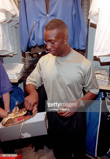 Niketown#2.0815.CW 1996 Olympic 200 and 400 meter gold medalist Michael Johnson puts his gold shoes away during the Niketown Los Angeles store...
