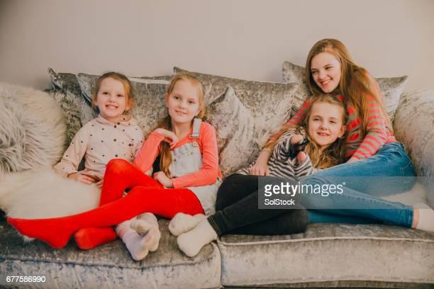 Meningitis Survivor Watching T.V with her Sisters