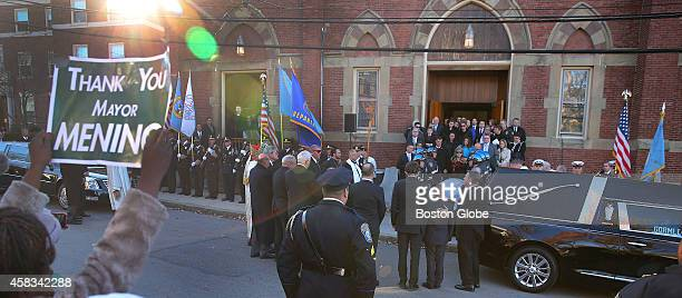 Menino family members gather outside the church after Mass for Boston mayor Thomas M Menino's funeral