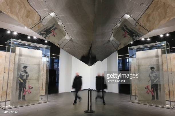 TORONTO ON FEBRUARY 16 Menkes development has 'rescued' a work allegedly created by Banksy They have put it behind glass in the PATH walkway on the...