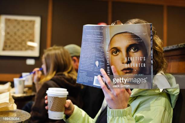 Menlo Park, California I was sitting in this coffee shop with reader next to me placing book in a way that made the cover photo appear to be her face.