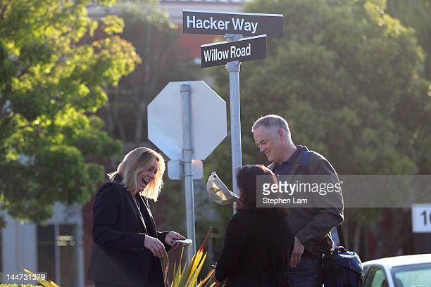 Menlo Park Mayor Kirsten Keith chats with a Facebook employee outside Facebook headquarters May 18, 2012 in Menlo Park, California. The...