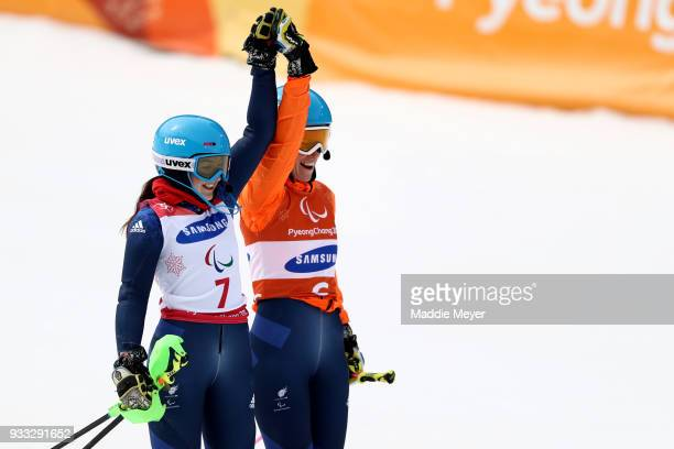 Menna Fitzpatrick of Great Britain and her guide Jennifer Kehoe celebrate after winning the gold medal in the Women's Visually Impaired Slalom at...