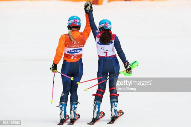 Menna Fitzpatrick of Great Britain and her guide Jennifer Kehoe celebrate after Women's Slalom Visually Impaired on day nine of the PyeongChang 2018...