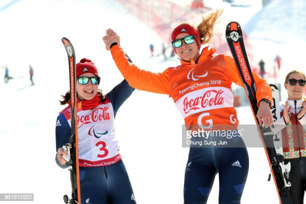 Menna Fitzpatrick of Great Britain celebrates with her guide Jennifer Kehoe at the victoey ceremony in the Alpine Skiing Women's Super Combined...