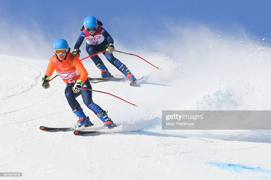 Menna Fitzpatrick (back) of Great Britain competes in the Women's Super-G Visually Impaired on day two of the PyeongChang 2018 Paralympic Games on March 11, 2018 in Pyeongchang-gun, South Korea.