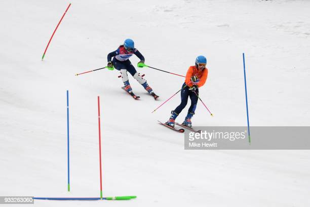 Menna Fitzpatrick of Great Britain follows her guide Jennifer Kehoe during the Women's Slalom Visually Impaired on day nine of the PyeongChang 2018...