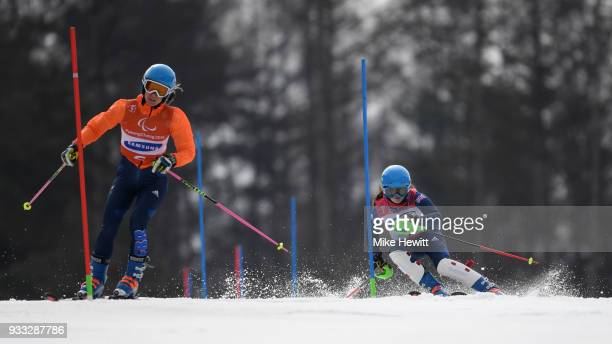 Menna Fitzpatrick of Great Britain on her way to the Gold medal with her guide Jennifer Kehoe in the Women's Slalom Visually Impaired on day nine of...