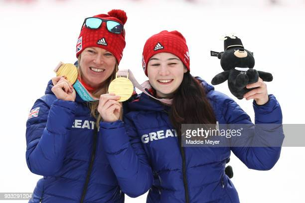 Menna Fitzpatrick of Great Britain right and her guide Jennifer Kehoe celebrate after winning the gold medal in the Women's Visually Impaired Slalom...
