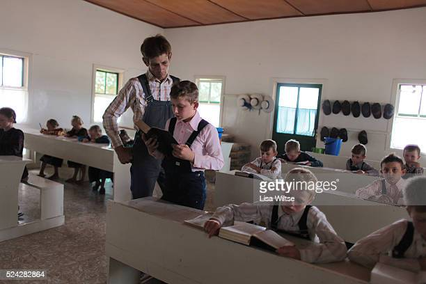 Mennonite Students from camp 2 in the colony of Manitoba Bolivia learning the German alphabet at school Boys attend school from the ages 6 to 12...