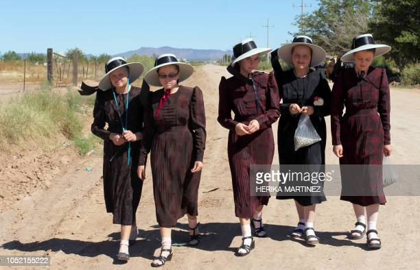 TOPSHOT Mennonite young women walk at the Sabinal community in Ascencion municipality Chihuahua State Mexico on September 22 2018 Isolated from...