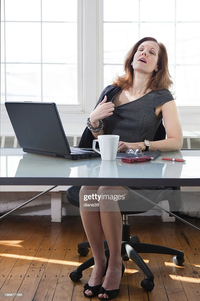 hot office pic. Menopausal Woman Having A Hot Flash At The Office : Stock Photo Pic Getty Images