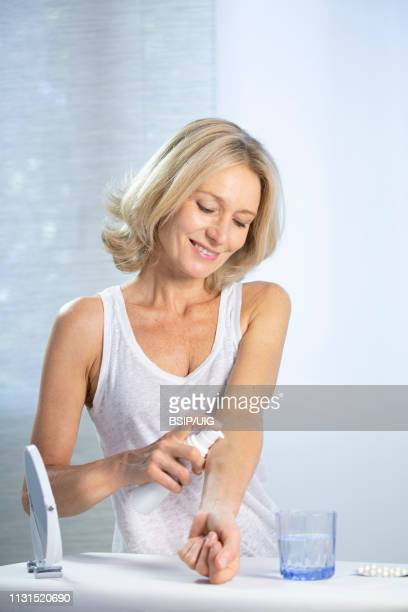 a menopausal woman using hrt. - hrt pill stock pictures, royalty-free photos & images
