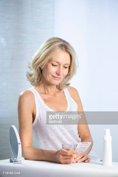 a menopausal woman using hrt. - oestrogen stock pictures, royalty-free photos & images