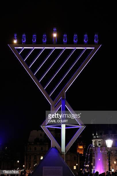 Menorah is lit on December 20, 2011 to mark the beginning of the Jewish festival of Hanukkah in Trafalgar Square in London. AFP PHOTO/CARL COURT
