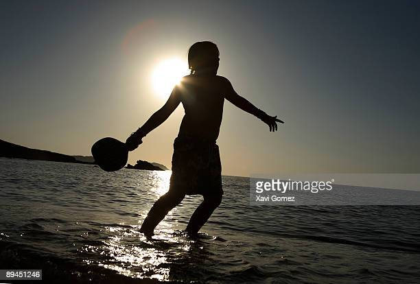 Menorca Balearics Islands Spain Children playing with the raquets on a beach