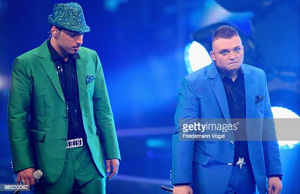 Menowin Froehlich and Mehrzad Marashi reacts after the contest 'DSDS Deutschland Sucht Den Superstar' final show on April 17 2010 in Cologne Germany