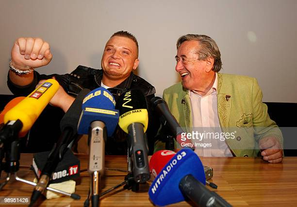 Menowin Froehlich and Richard Lugner joke during a press conference at Lugner City on May 10 2010 in Vienna Austria