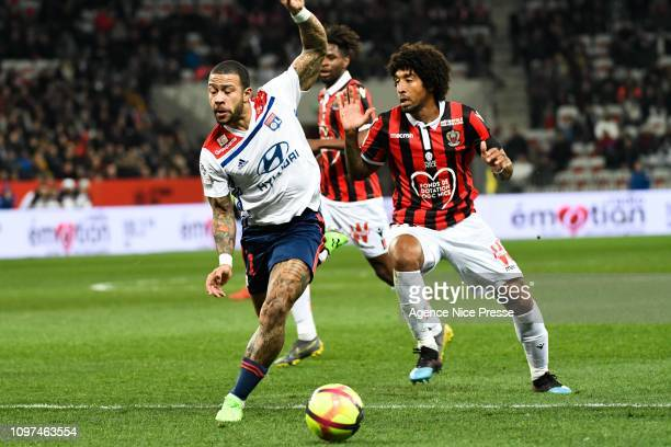 Menphis Depay of Lyon and Dante of Nice during the Ligue 1 match between Nice and Lyon at Allianz Riviera on February 10 2019 in Nice France