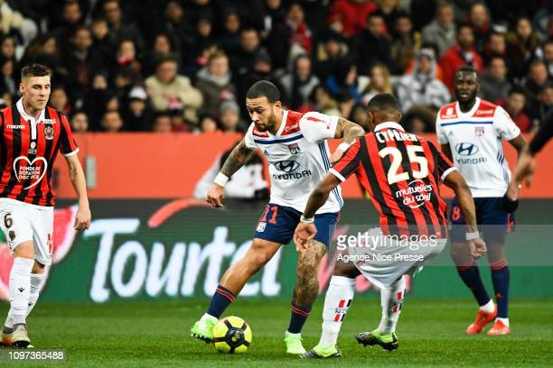Menphis Depay of Lyon and Wylan Cyprien of Nice during the Ligue 1 match between Nice and Lyon at Allianz Riviera on February 10 2019 in Nice France