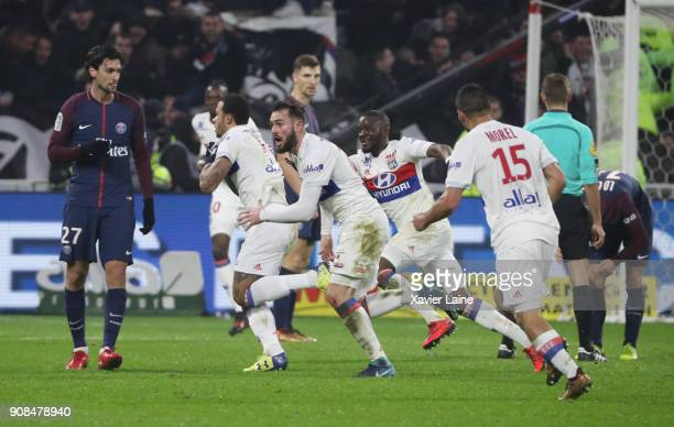 Menphis Depay of Olympique Lyonnais celebrate his goal of the victory with teammattes and Javier Pastore of Paris SaintGermain is disapointed during...