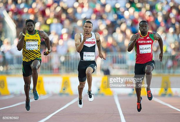 Men's 100 meter dash Jason LivermoreJamaica Andre DegrasseCanada and Antoine AdamsSt Kitts and Nevis during athletics competition at the 2015 PanAm...