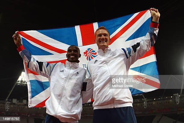 Men's 10,000m gold medalist Mohamed Farah of Great Britain and Men's Long Jump gold medalist Greg Rutherford celebrate on Day 8 of the London 2012...