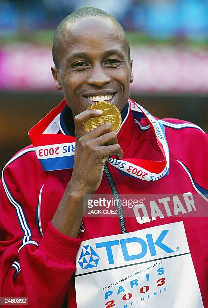 Men's 3,000m steeplechase gold medal winner Saif Saeed Shaheen of Qatar poses on the podium 27 August 2003 during the 9th Athletics World...
