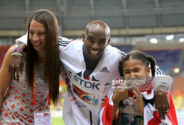 Men's 5000 metres Gold medalist Mo Farah of Great Britain poses with his daughter Rhianna Farah and wife Tania Farah during Day Seven of the 14th...