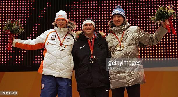 Men's 5000m Speed Skating silver medal winner Sven Kramer of Netherlands gold medal winner Chad Hedrick of the United States and bronze winner Enrico...