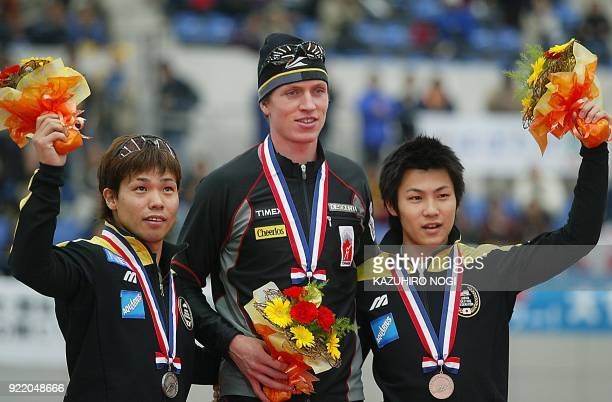 Men's 500m race winners champion Jeremy Wotherspoon of Canada second placer Hiroyasu Shimizu of Japan and third placer Jojo Kato of Japan celebrate...