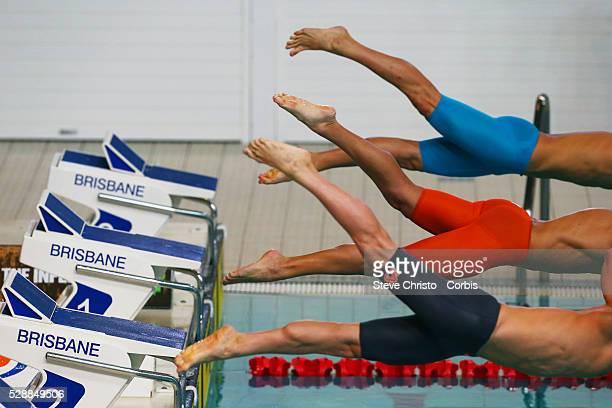 Men's 50m freestyle heats starters dive in from the blocks at the Brisbane Aquatic Centre Brisbane Australia Saturday 5th April 2014