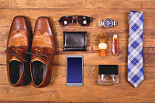 Men's accessories organized on table in knolling arrangement