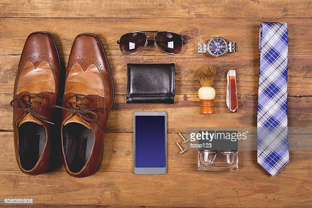 men's accessories organized on table in knolling arrangement - men fashion stock photos and pictures