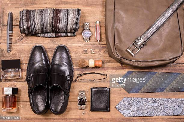 Men's accessories organized on table.  No people.  Knolling.