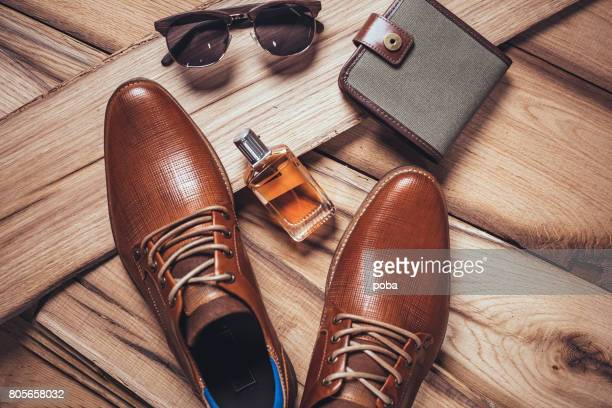 men's accessories organized on wooden table - personal accessory stock pictures, royalty-free photos & images