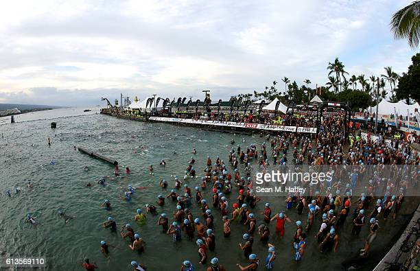 Men's age group competitors enter the water prior to the start of the 2016 IRONMAN World Championship triathlon on October 8 2016 in Kailua Kona...