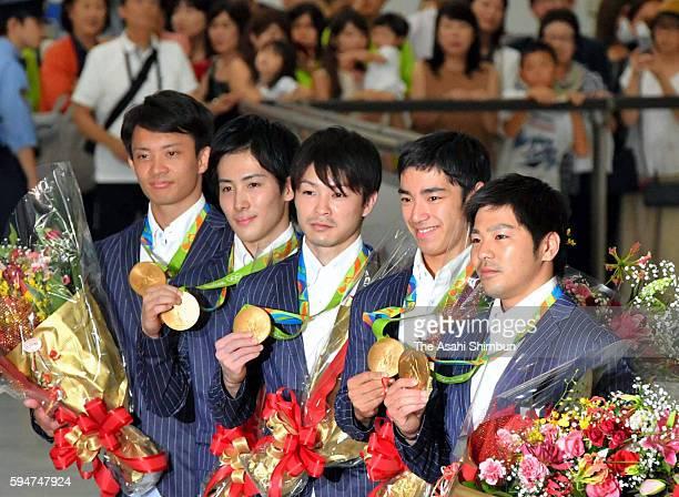 Men's Artistic Gymanstics Team gold medalists Yusuke Tanaka Ryohei Kato Kohei Uchimura Kenzo Shirai and Koji Yamamuro of Japan pose with their medals...