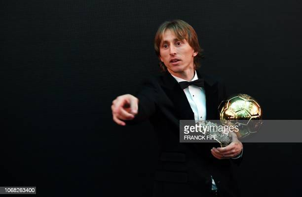 Men's Ballon d'Or award for best player of the year's Real Madrid's Croatian midfielder Luka Modric poses with the trophy after the 2018 Ballon d'Or...