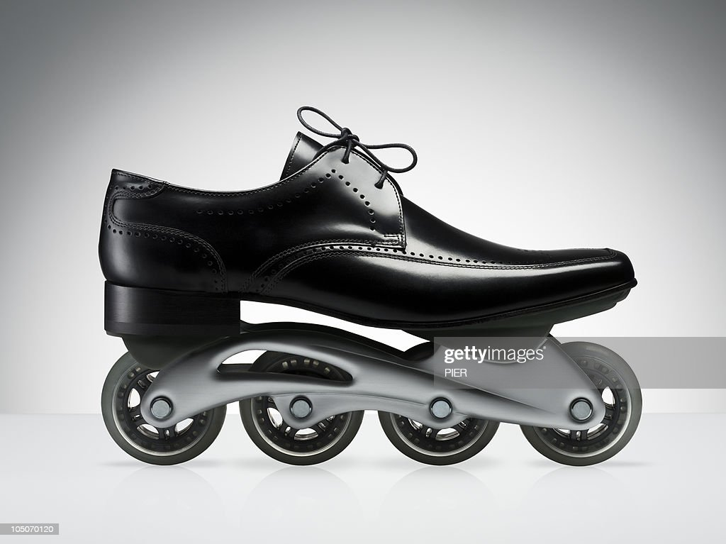 Mens Black Business Shoe With Rollerblade Wheels Stock ...