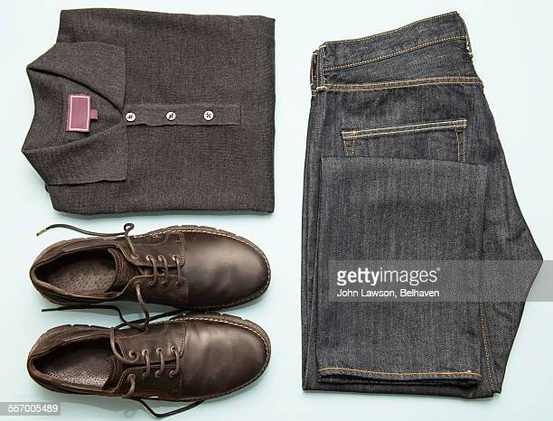 mens' clothes neatly organised - brown jeans stock photos and pictures