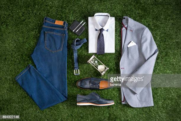 men's clothing isolated on grass background - men fashion stock photos and pictures