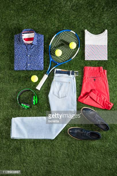 men's clothing with personal accesorries isolated on grass background - tee sports equipment stock pictures, royalty-free photos & images