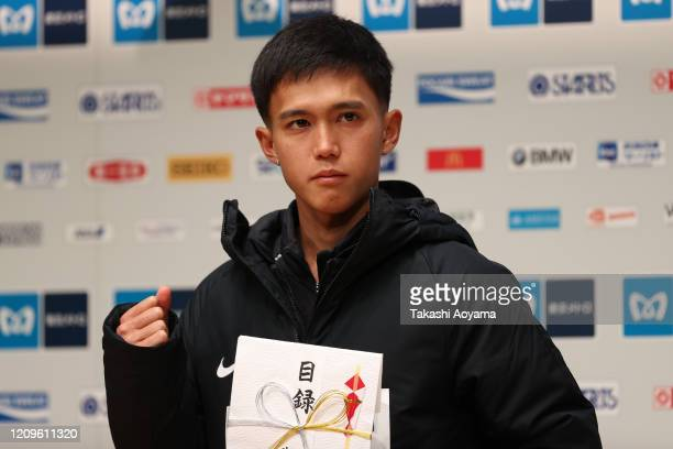 Men's competition fourth place and new Japanese national record holder Suguru Osako of Japan poses for photograph during the awards ceremony...