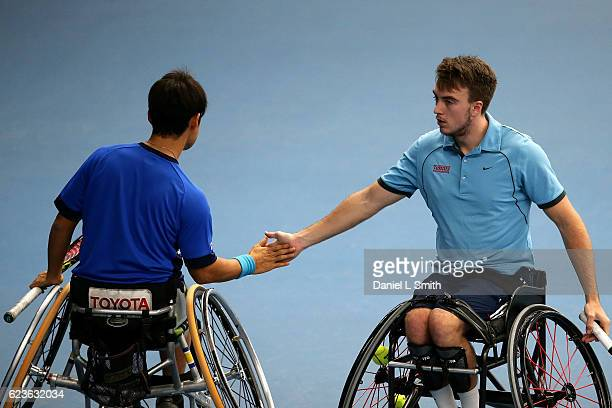Mens doubles pair Dermot Bailey of Great Britain and Takuya Miki of Japan tap hands between points in their men's doubles match against Daniel...