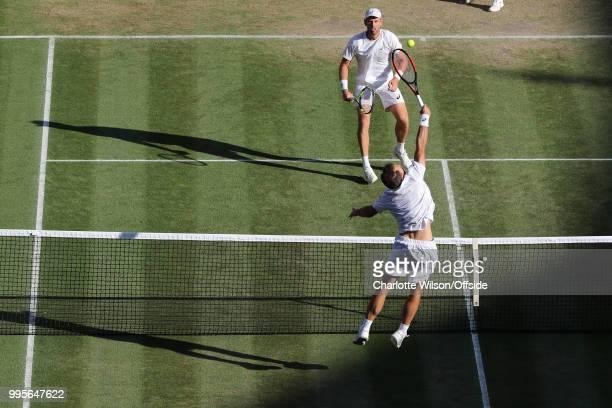 Mens Doubles - Raven Klaasen & Michael Venus v Jamie Murray & Bruno Soares - Bruno Soares jumps up to return the ball to Michael Venus at All England...
