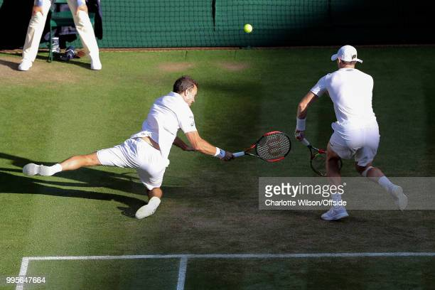 Mens Doubles - Raven Klaasen & Michael Venus v Jamie Murray & Bruno Soares - Bruno Soares slips and falls as he and Jamie Murray lunge for the ball...