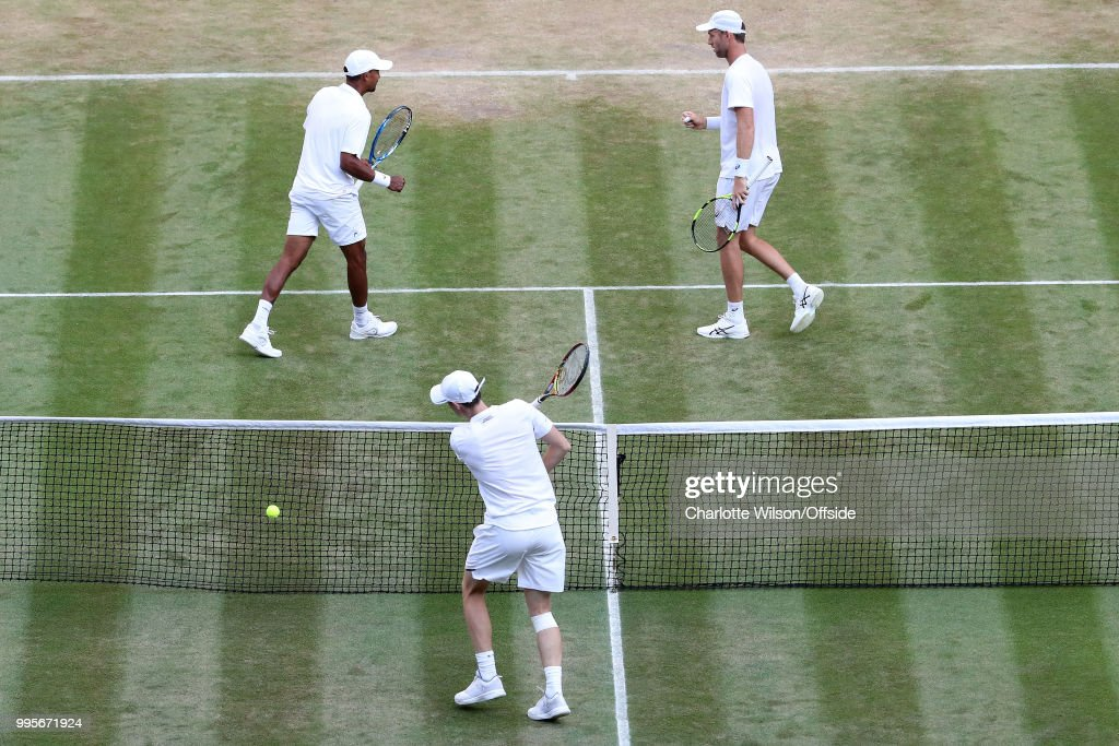 Mens Doubles - Raven Klaasen & Michael Venus v Jamie Murray & Bruno Soares - Raven Klaasen (RSA) and Michael Venus (NZL) celebrate winning a point as a dejected Jamie Murray (GBR) hits the ball into the net with frustration at All England Lawn Tennis and Croquet Club on July 10, 2018 in London, England.