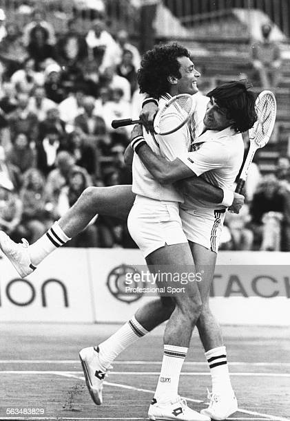 Men's doubles tennis partners Ilie Nastase of Romania and JoseLuis Clerc of Argentina embrace during a match at the Monte Carlo Tennis Open in Monaco...