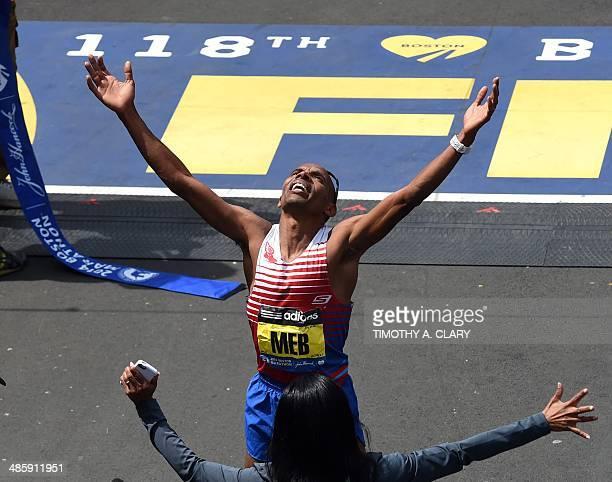 Men's Elite division winner Meb Keflezighi of the US reacts as he crosses the finish line during the 118th Boston Marathon in Boston, Massachusetts...
